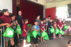 Aranui school students receiving their Replay sports gear in December.