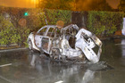 The burnt-out wreckage of a car that crashed after a police chase in Christchurch earlier this month. Photo / supplied