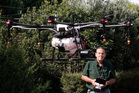 Pilot Warrick Funnell operates Agdrone's agricultural spraying drone.