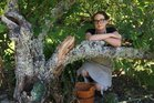 Kerikeri Mission Station visitor host Harriet Barker-Reid with a plum tree stripped of fruit and broken by thieves.