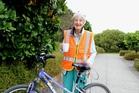 Sally Mathieson, 80, enjoying a cuppa after cycling from Waikanae to Paraparaumu Library. Photo / Rosalie Willis